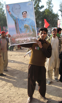 A supporter brandishes Benazir Bhutto's photo at an election rally in Faisalabad, Punjab(photo: Tony Cross)
