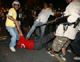 A government supporter is kicked by an anti-government demonstrator (Photo: Reuters)