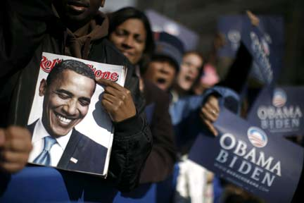 Keeping it covered ... Obama supporters brandish Rolling Stone magazine's coverage of their hero(Photo: Reuters)