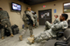 US soldiers watch a television program on the election in Bagram airbase north of Kabul(Photo: Reuters)