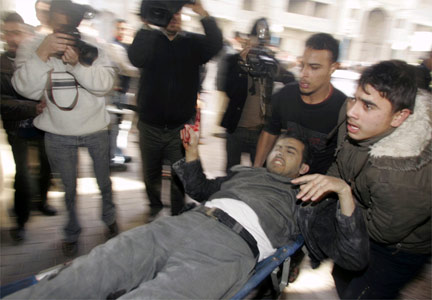 A wounded Palestinian man is carried to hospital.(Photo: Reuters)