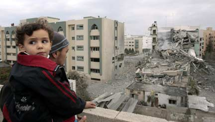 A Palestinian man looks at a destroyed building of the Islamic University(Photo: Reuters)