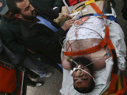 Injured Palestinian man being loaded onto an ambulance.(Photo: Reuters)