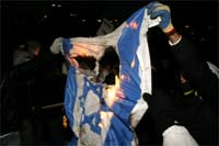 Demonstrators burn an Israeli flag in paris, 10 January 2009(Photo: Reuters)