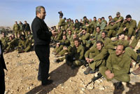Israel's Defence Minister Ehud Barak speaks to reservists in southern Israel(Photo: Reuters)