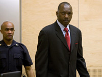 Thomas Lubanga (R) enters court at the beginning of his trial a(Photo: ICC handout)