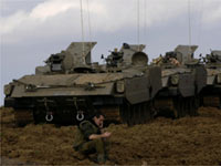 Israeli tanks lined up just outside the central Gaza Strip(Credit: Reuters)