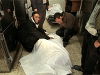 Palestinians react beside bodies in Shifa hospital in Gaza(Credit: Reuters)