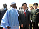 Chinese president Hu Jintao walks with Senegal president Abdoulaye Wade(Photo: AFP)