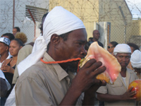 A Musician blows a conch shell during the funeral march, a symbol of the emancipation of slavery.(Photo: Sarah Elzas)