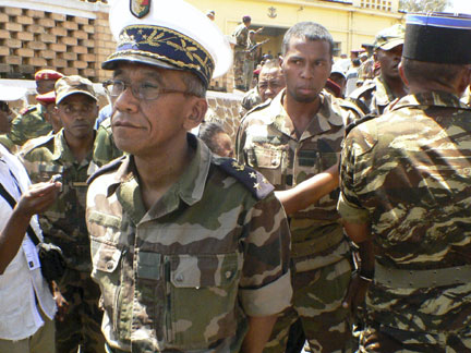 Madagascan Defence Minister Mamy Ranaivoniarivo (L) walks past soldiers in Madagascan capital Antananarivo on Tuesday(Photo: Reuters)