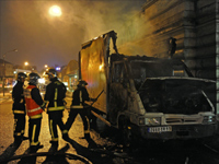 Firefighters put out a truck that was set alight by Tamil protesters in Paris.(Photo: Reuters)