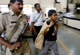 Armed police protect a boy carrying voting material in Mumbai in 2009(Photo: Reuters)