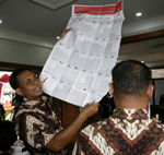 Find your way around this! A polling station officer looks at a ballot paper during counting(Photo: Reuters)