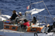 Armed pirates are seen aboard the French yacht Tanit off Somalia(Photo: Reuters/French navy handout)