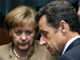 Germany's Chancellor Angela Merkel and French President Nicolas Sarkozy (R) at an EU leaders summit in Brussels on 20 March 2009.(Photo: Reuters)
