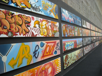 "Some of the standard sized canvases that graffiti artists worked over with the theme ""love"""