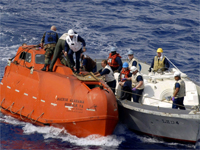 The lifeboat used in the kidnap of Captain Phillips is towed away for evidence on 13 April 2009(Photo: Reuters)