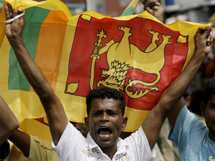 A man celebrates the Sri Lankan government's victory over the Tamil Tigers in Colombo, 17 May 2009(Photo: Reuters)