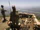 Pakistani soldiers looking over the Swat valley from a bunker on Baine Baba Ziarat mountain on 22 May(Photo: Reuters)