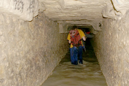 The author trudges along a flooded passage.(Photo: Vincent)