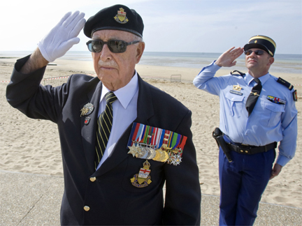 A Veteran Stands To Attention In Bernieres Sur Mer On 5 JunePhoto