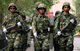 Armed Chinese soldiers in riot gear march along a main street in the city of Urumqi(Photo: Reuters)
