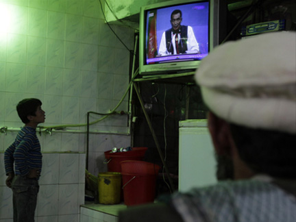 The presidential debate is televised in a restaurant in Kabul on Sunday(Photo: Reuters)