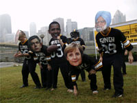 Demonstrators wearing masks of leaders play a mock football game urging world leaders to tackle global poverty(Credit: Reuters)