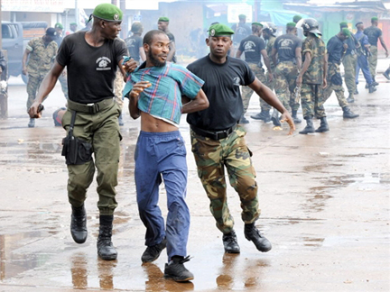 Guinean police arrest a demonstrator in the capital, Conakry, on Monday(Photo: Seyllou/AFP)