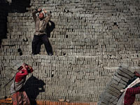 Young workers carrying bricks on their back(Credit: Luca Catalano-Gonzaga)