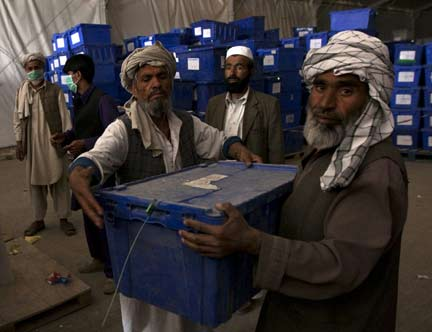 Election workers load ballot boxes onto a truck to be transported to the provinces, at a warehouse in Kabul (Photo: Reuters)