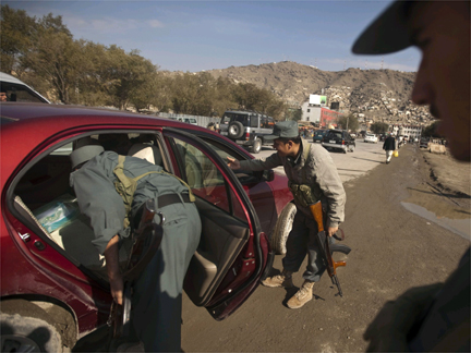 Afghan policemen search a car at a checkpoint in Kabul.(Photo: Reuters)