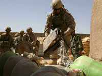 US Marines pour gasoline on bags of confiscated poppy seeds in Helmand province(Credit: Reuters)