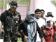 An army officer escorts Andal Ampatuan Jr. (C), mayor of Datu Unsay town, after he surrendered in Ampatuan, Maguindanao in southern Philippines 26 November 2009.(Photo: Reuters)