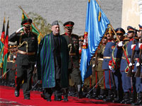 Hamid Karzai inspects the guard of honour before his inauguration as President in Kabul, 19 November 2009.(Photo: Jerry Lampen/Reuters)