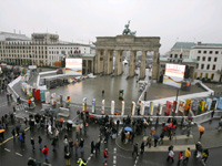 Crowds on Monday walk near giant dominos placed along a stretch of the Berln Wall's original path, near the Brandenburg Gate(Photo: Reuters)
