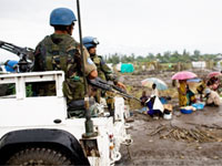 UN soldiers pass near a UN mission in DR Congo (MONUC) base at Kiwanja, about 80 km north of Goma(Photo: AFP)