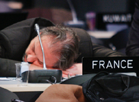 A French delegate sleeps during all-night discussions at Copenhagen(Photo: Reuters)