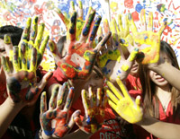 Students show their handprints in support of the global day of action in Quezon City, Metro Manila (Photo: Reuters)