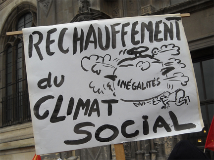A placard reading <em>Social Climate Change</em> at the Flash Mob in Paris on 5 December