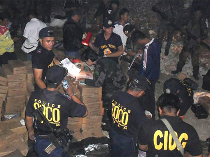 The weapons cache discovered near the Ampatuan family compound on 3 December(Photo: Reuters)