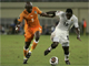 Didier Zokora of Ivory Coast challenges Asamoah Kwadwo of Ghana during their match in Cabinda(Photo: Reuters)