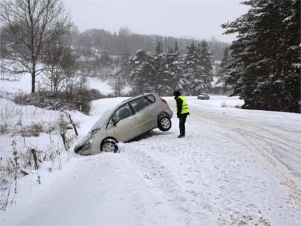 A man looks at his car after it has fallen into a ditch in the snow near Le Monastier sur Gazeille, central France(Photo: Reuters)