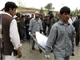 Hospital workers carry the body of a man killed in the Lashkar Gah blast(Photo: Reuters)