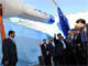 Iranian President Mahmoud Ahmadinejad looks at the rocket during a ceremony in Tehran on 3 February(Photo: Reuters)